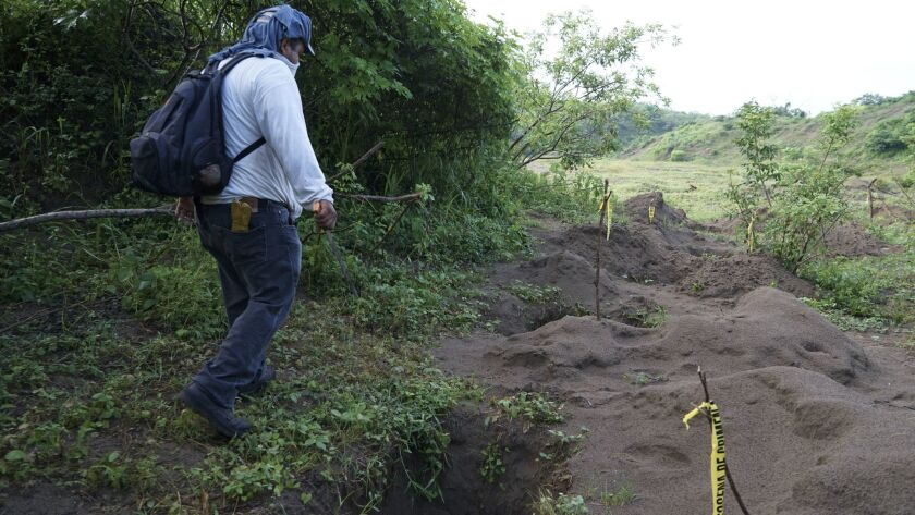 In August 2016, Rufino Bustamante, whose son is missing, joined other relatives to search for loved ones possibly buried in a clandestine gravesite on the northern fringes of Veracruz city.