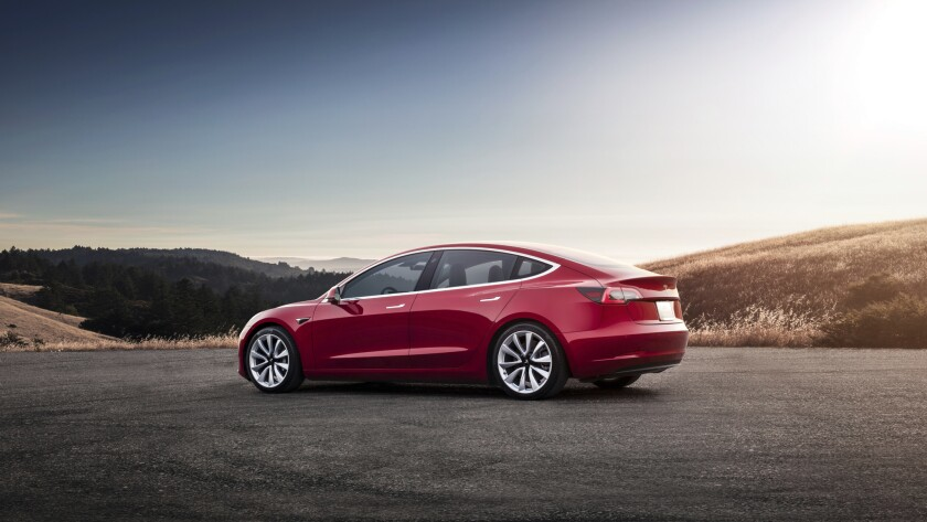 This undated photo provided by Tesla shows the Tesla Model 3, which delivers a sporty ride with a pr