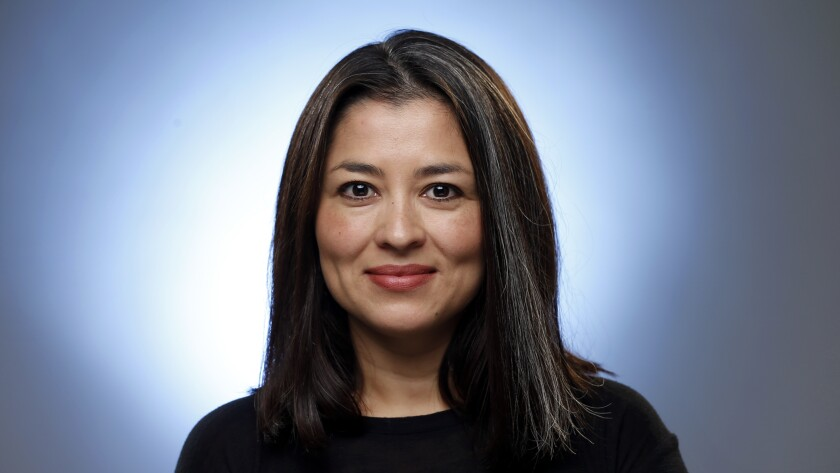 Esmeralda Bermudez writes narrative stories about the lives of Latinos for the Los Angeles Times.