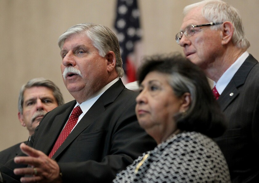 Interim Sheriff John Scott, center, is flanked by L.A. County Supervisors Zev Yaroslavsky, left, Gloria Molina and Mike Antonovich during a January press conference.