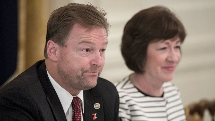 Nevada Senator Dean Heller and Maine Senator Susan Collins attend a meeting on healthcare legislatio