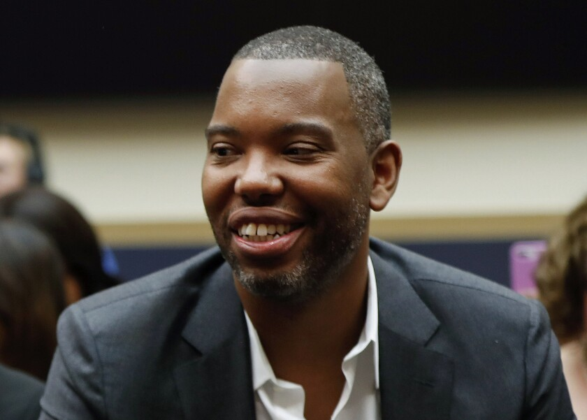 """FILE - In this Wednesday, June 19, 2019, file photo, author Ta-Nehisi Coates attends a hearing at the Capitol in Washington. Coates' first novel, """"The Water Dancer,"""" is among the nominees for an Andrew Carnegie Medal for Excellence. Winners will be announced Jan. 26, 2020. (AP Photo/Pablo Martinez Monsivais, File)"""