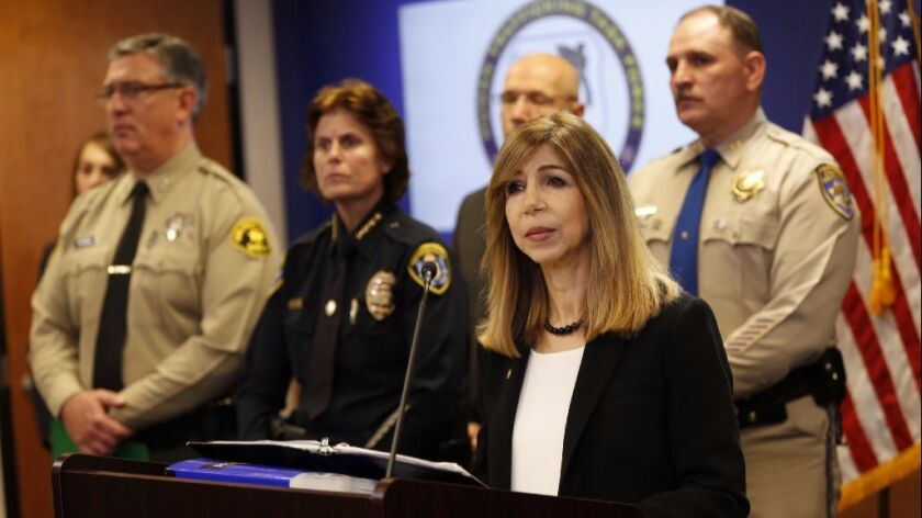 Chief Deputy District Attorney Summer Stephan, right, speaks at a January 2017 news conference about arrests in a human trafficking operation. Stephan is running for district attorney in 2018.