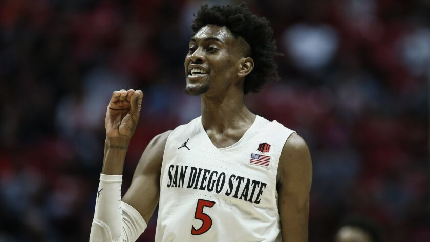San Diego State forward Jalen McDaniels (5) gestures to UNLV forward Joel Ntambwe (24) as the pair exchange words during the first half of an NCAA college basketball game on Saturday, Jan. 26, 2019,