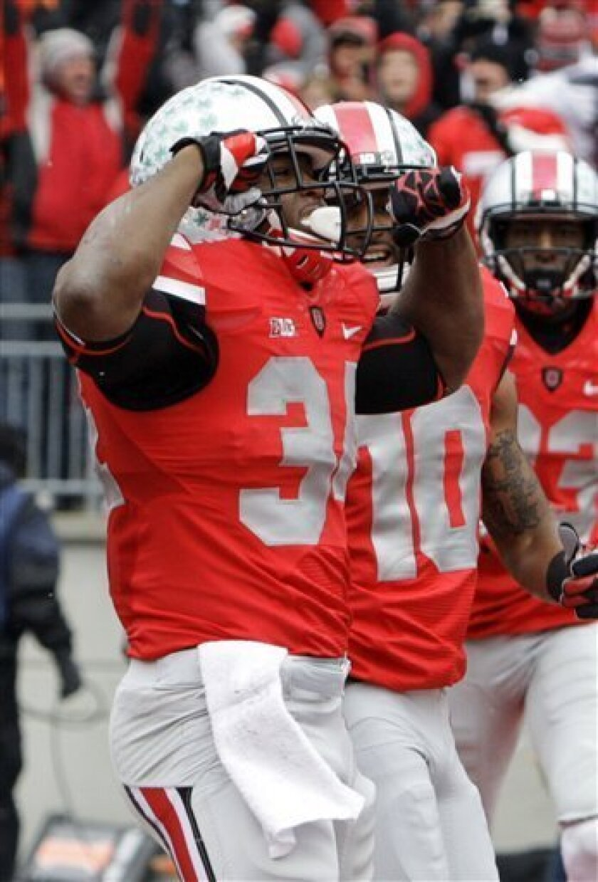 FILE - In this Nov. 24, 2012 file photo, Ohio State running back Carlos Hyde (34) celebrats after a 3-yard touchdown run against Michigan in the first quarter of an NCAA college football game in Columbus, Ohio. Coming off a 12-0 season, Ohio State opens spring practice on Tuesday, March 5, 2013 .(A