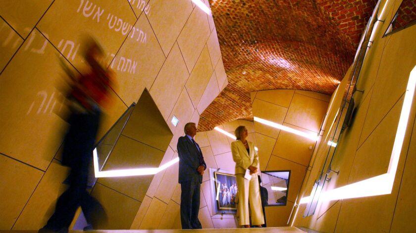 Visitors walk through the Jewish Museum in Copenhagen in 2004.