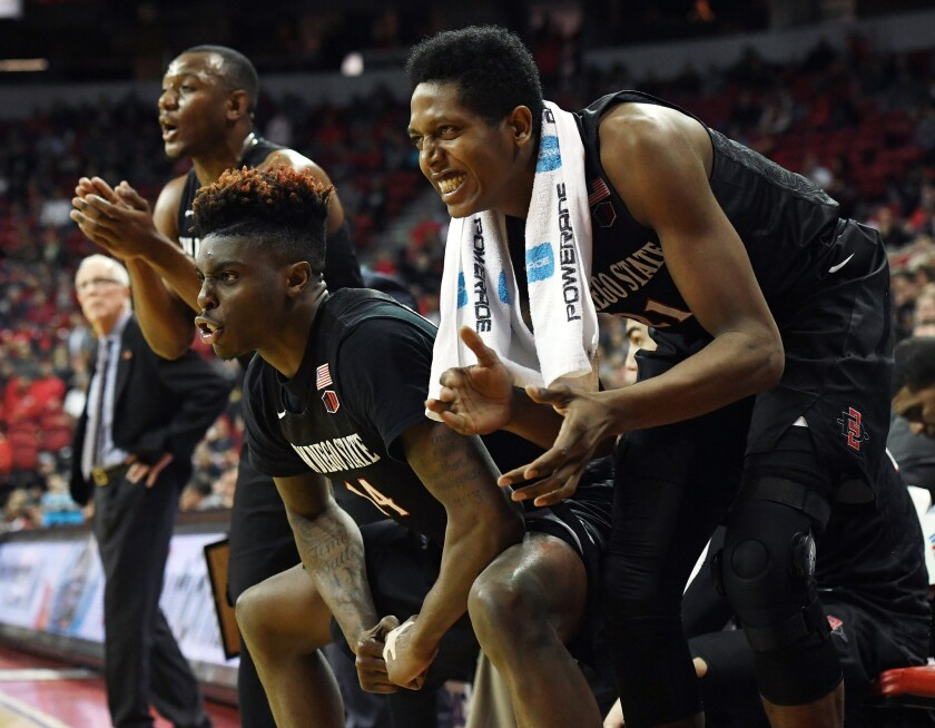 SDSU's Zylan Cheatham (14) and Malik Pope celebrate on the bench late in their 64-51 win against UNLV at the Thomas & Mack Center on Tuesday.