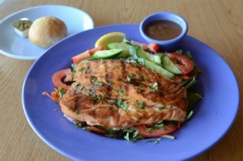 Grilled Salmon Salad uses romaine lettuce, cucumbers and tomato. Photos by Kelley Carlson