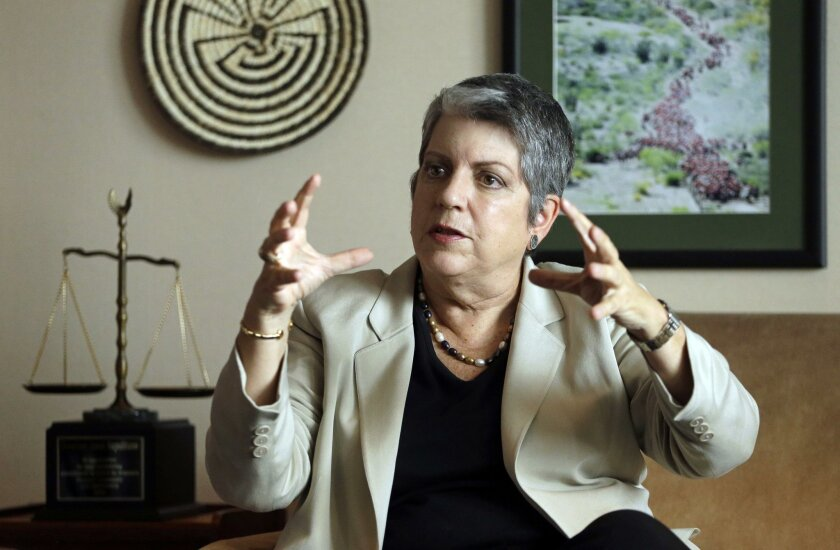 FILE - In this Sept. 30, 2014, file photo, University of California President Janet Napolitano gestures while speaking during an interview in Oakland, Calif. Napolitano is recommending tuition increases in each of the next five years as a way to keep the public university system going and growing a