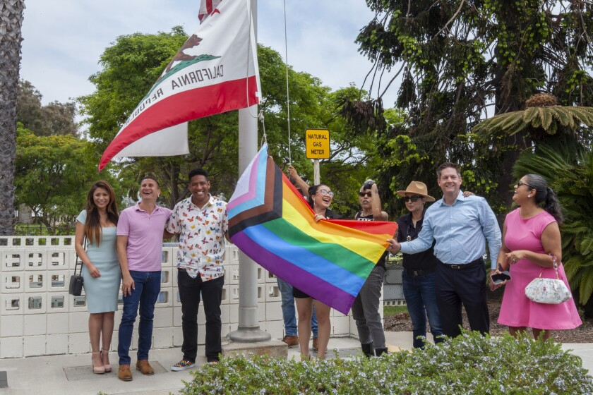 City leaders raise the Pride flag at National City City Hall on Wednesday, June 16, 2021, for the first time.