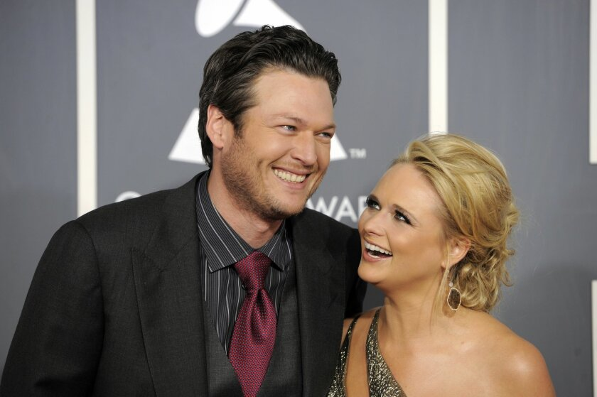 FILE - In this Feb. 13, 2011 file photo, Blake Shelton, left, and Miranda Lambert arrive at the 53rd annual Grammy Awards in Los Angeles. Shelton and Lambert announced their divorce after four years of marriage. Shelton's spokesman provided a statement from the couple on Monday, July 20, 2015. (AP Photo/Chris Pizzello, File)