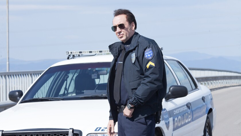 "Nicolas Cage as Mike Chandler in the action / thriller film ""211"" a Momentum Pictures release. Credi"