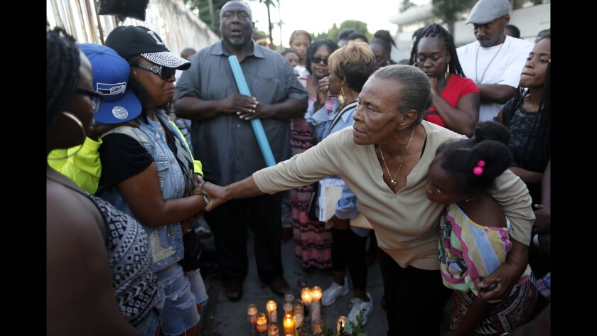 Family and friends gather for a vigil for 16-year-old Elijah Galbreath, who was gunned down Sunday afternoon in Watts.