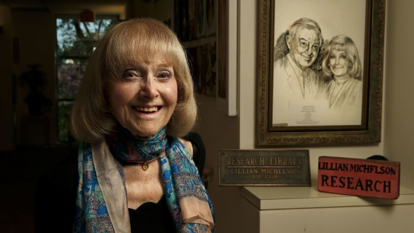 Lillian Michelson next to an artist's rendering of her and late husband Harold Michelson at her home in Woodland Hills.
