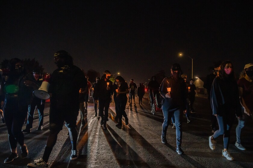 Protesters march for the fourth anniversary of Alfred Olango's death in El Cajon on September 27, 2020.