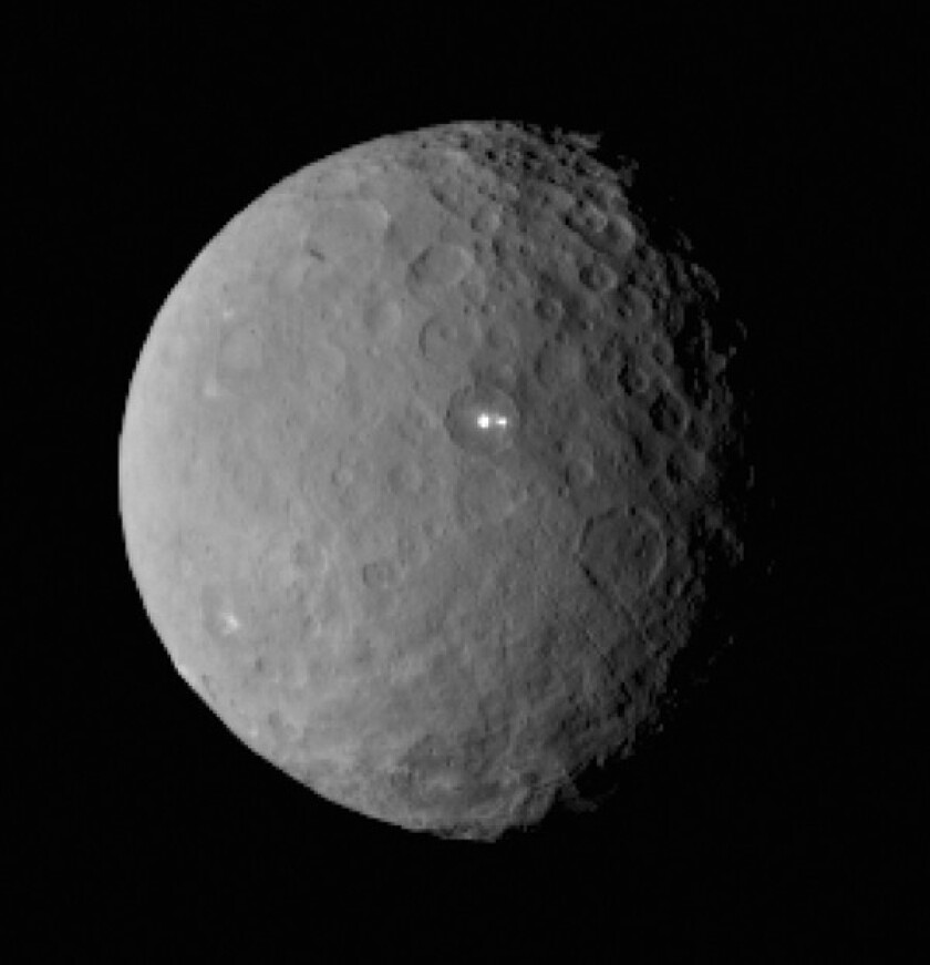This image taken by NASA's Dawn spacecraft Feb. 19 shows dwarf planet Ceres from a distance of nearly 29,000 miles. In it, the brightest spot on Ceres appears to have a dimmer companion lying in the same basin.