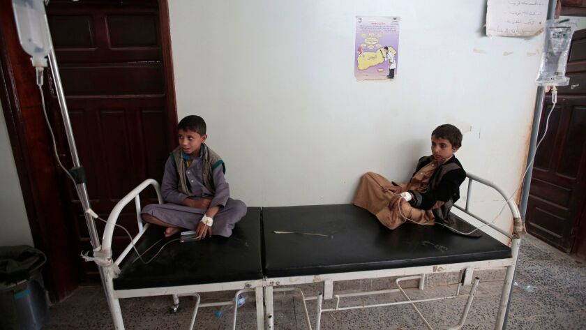 Boys are treated for a suspected cholera infection at a hospital in the Yemeni capital, Sana.