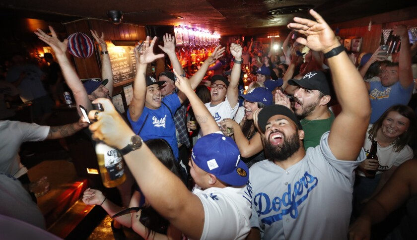 Dodgers fans celebrate playoff win.