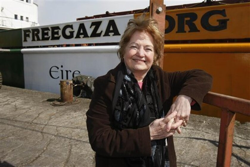 FILE -- In this May 12, 2010 file photo, Nobel Peace Prize laureate Mairead Maguire, poses alongside the cargo ship MV Rachel Corrie, named after a after a human rights activist killed by the Israeli military, before it departed from Dundalk , Ireland, for the Middle East with a cargo of cement and supplies for Gaza. The ship, on which Maguire is one of 11 passengers, could reach Israel's 20-mile (32-kilometer) exclusion zone by June 4, according to activists, but Israel's prime minister has vowed the ship will not reach land. The dueling comments suggest a potential new clash over Israel's three-year-old blockade of the Hamas-ruled Gaza Strip - and come only four days after an Israeli commando raid on a larger aid flotilla left nine activists dead.(AP Photo/Niall Carson-pa, file)