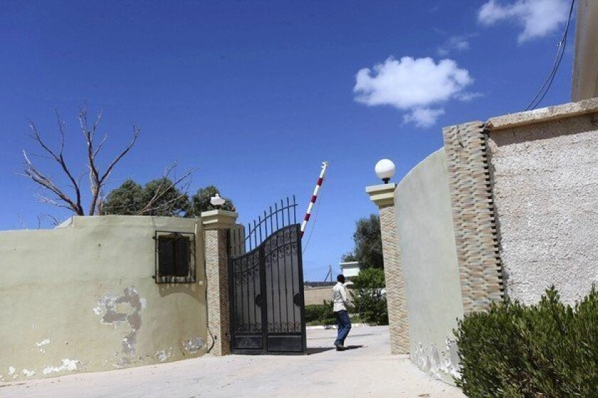 A man in Benghazi, Libya, makes his way near the safe house that was raided after the attack that killed U.S. Ambassador J. Christopher Stevens on Sept. 11.