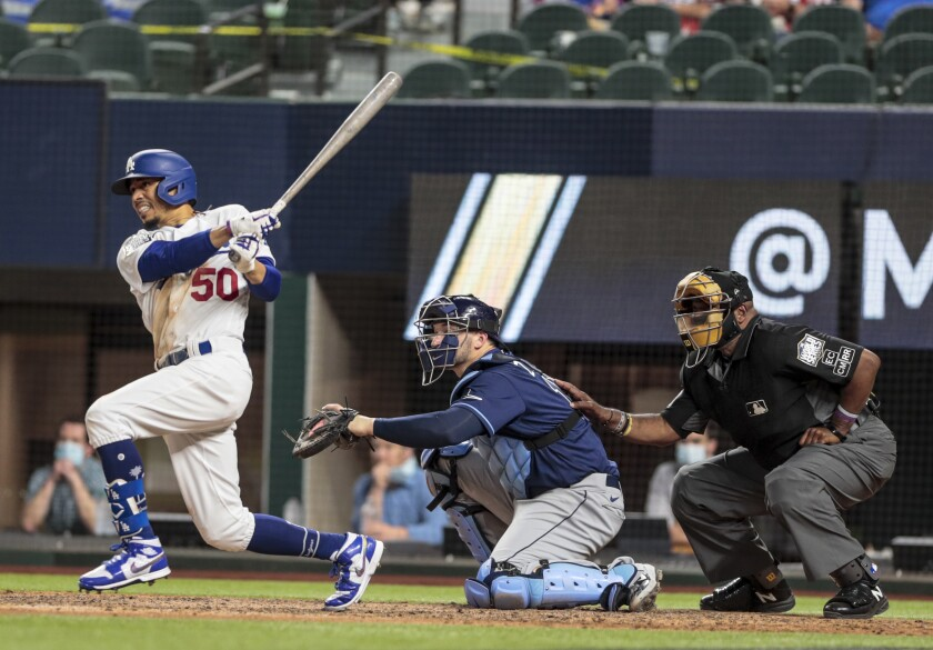 The Dodgers' Mookie Betts bats during the 2020 World Series.