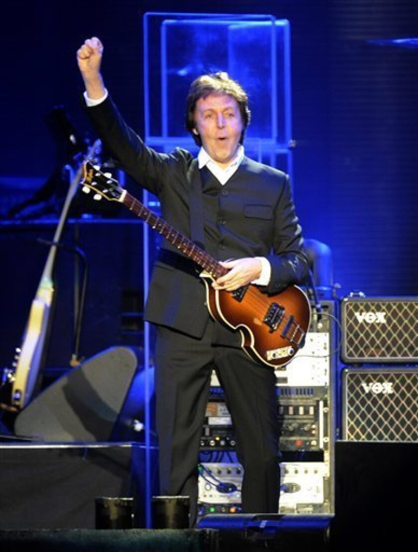 "British singer Paul McCartney performs during the opening concert of his ""Good Evening Europe"" tour, in Hamburg, Germany, on Wednesday, Dec 2, 2009. (AP Photo/Fabian Bimmer)"