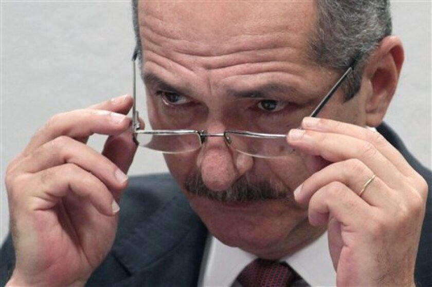 Brazil's Sports Minister Aldo Rebelo adjusts his glasses during a session by the Sports and Culture Commission at the Senate in Brasilia, Brazil, Tuesday April 10, 2012. The General Law of the 2014 World Cup, which sets guidelines for the organization of the international soccer tournament, was approved in March in the House of Representatives and awaits a vote in the Senate to take effect. (AP Photo/Eraldo Peres)