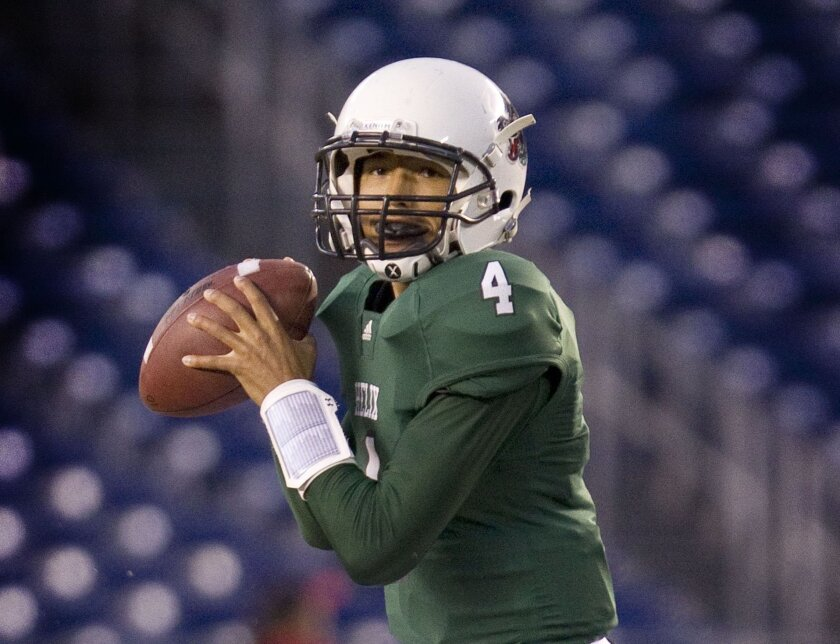 Helix quarterback Brandon Lewis, 25-3 as a starter, has passed for 34 TDs against seven interceptions this year.