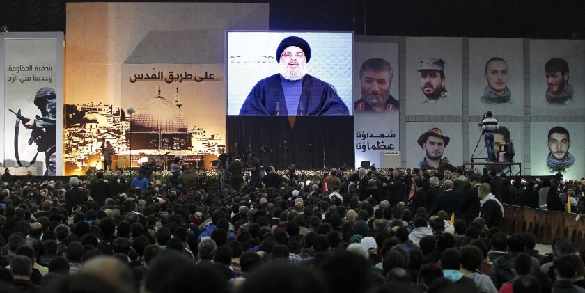 A crowd in Beirut watches a televised address by Hezbollah leader Hassan Nasrallah.