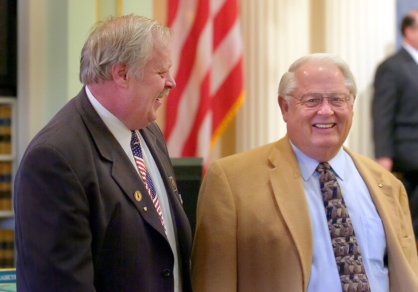 Former Assemblyman Richard Mountjoy, right, talks in 2006 with his son Dennis, who at the time was an Assembly member.