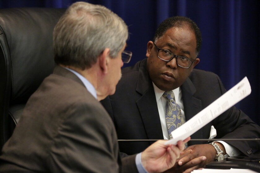 Mark Ridley-Thomas is seen talking to Zev Yaroslavsky, left, during a L.A. County Board of Supervisors meeting in June. Yaroslavsky will be succeeded by Sheila Kuehl.