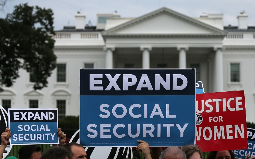 Activists participate in a rally in front of the White House last week, urging the expansion of Social Security benefits.
