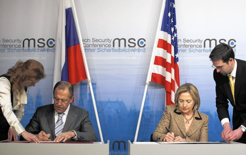 Russian Foreign Minister Sergei Lavrov and then-U.S. Secretary of State Hillary Rodham Clinton finalize the New START treaty in February 2011 in Munich, Germany.