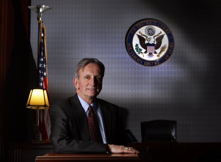 In this Jan. 6, 2015 photo federal Judge Edmund Sargus, head judge of the Southern District of Ohio poses for a photo in Columbus, Ohio. A federal trial over a $100 million investors' lawsuit against Venezuela includes allegations of fraud, hints of an international criminal conspiracy and referenc