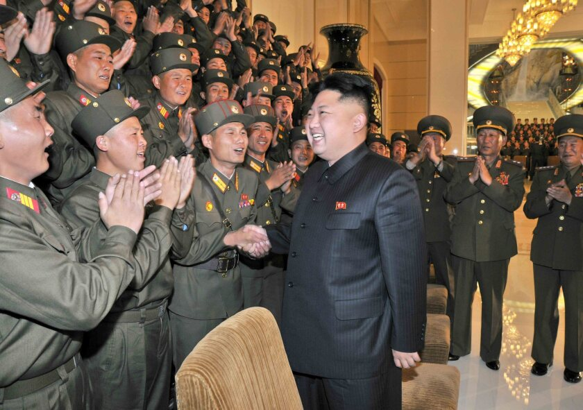 A picture released by the North Korean Central News Agency in October 2013 shows North Korean leader Kim Jong Un as he is welcomed by a group of soldiers picked to participate in a military art festival in Pyongyang.