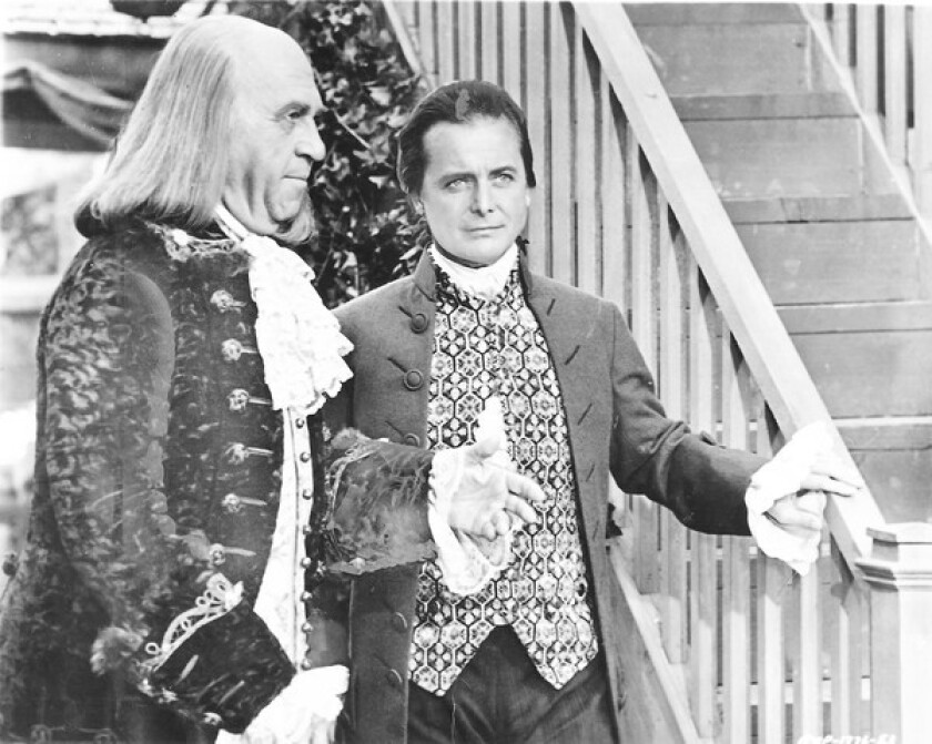 "Howard Da Silva as Benjamin Franklin, left, and William Daniels as John Adams in the movie adaptation of ""1776."""