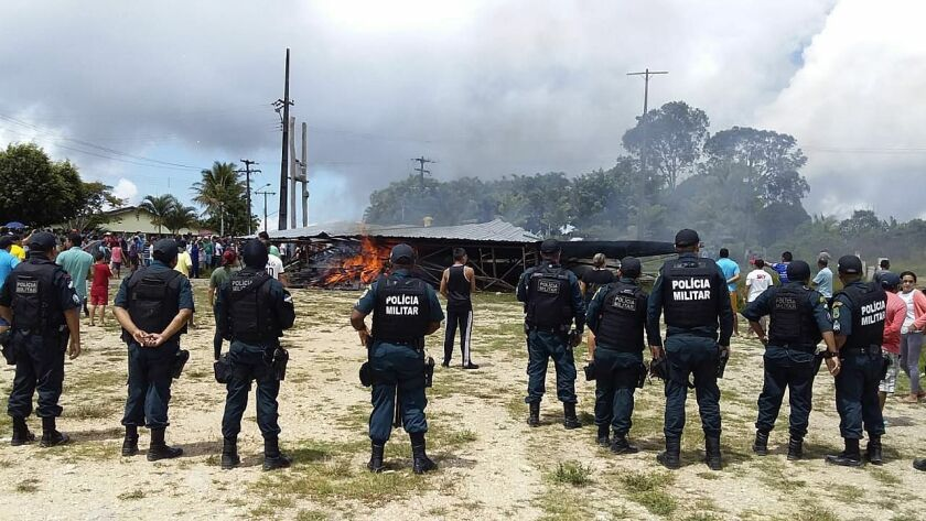 Police try to maintain control as Brazilian people demonstrate Aug. 18 against the presence of Venezuelan immigrants in Pacaraima, Brazil.