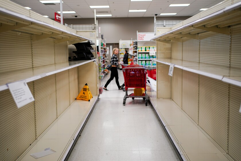 Amid coronavirus hoarding, stores are empty at a Manhattan Beach Target on Friday