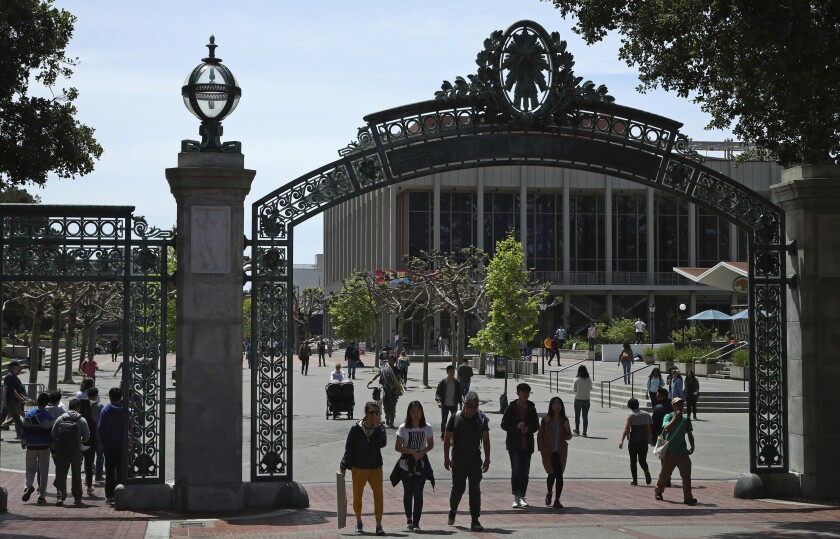 Students walk past Sather Gate on the University of California at Berkeley campus in Berkeley, Calif.