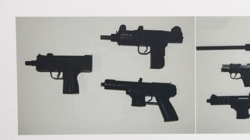 Photographs showing some of guns confiscated during the investigation of alleged illegal gun sales b