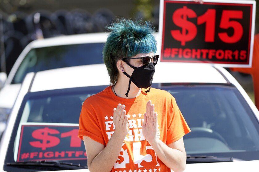 Cristian Cardona, an employee at a McDonald's, attends a rally for a $15 an hour minimum wage.