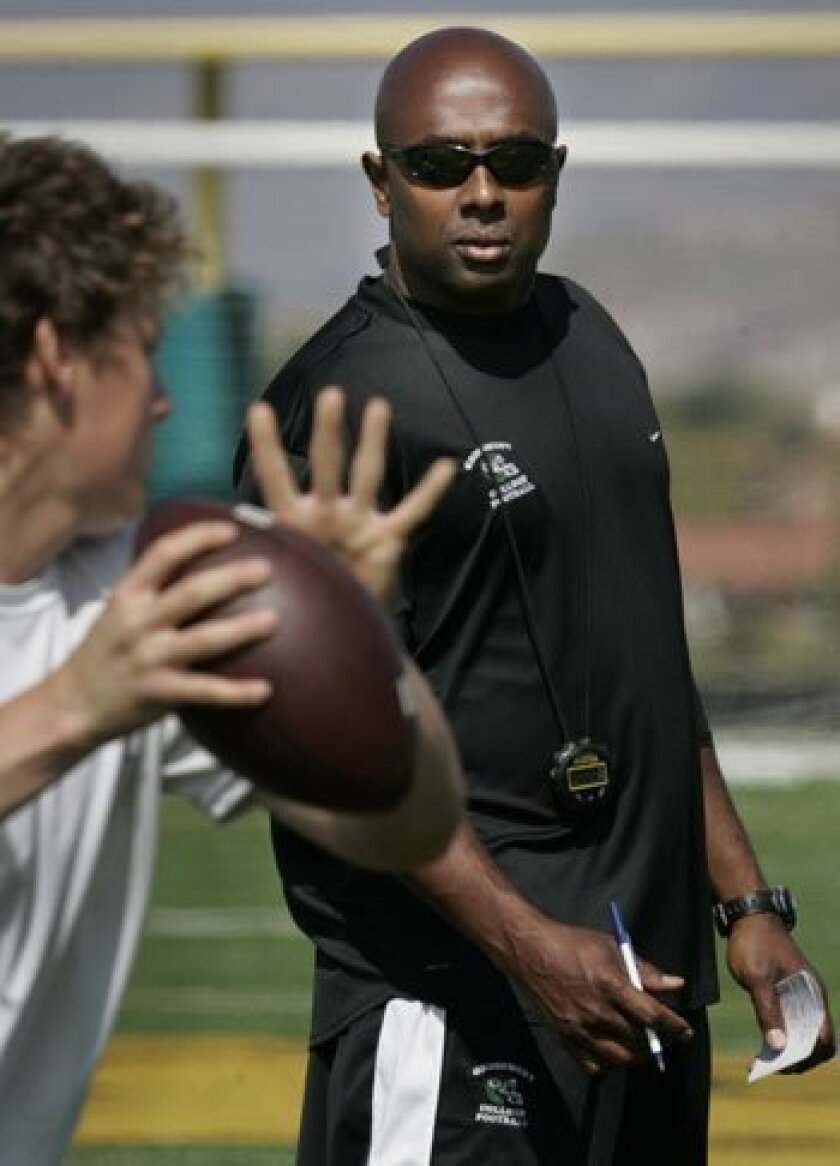 Former first-round draft pick Akili Smith (right), a Lincoln High alum, is now Grossmont College's quarterbacks coach, a job he performs for free.