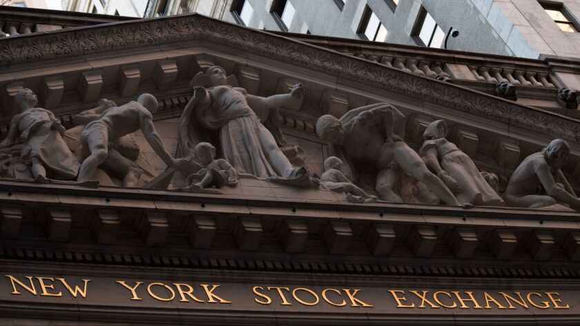 FILE - This Tuesday, Oct. 25, 2016, file photo shows the New York Stock Exchange at sunset, in lower