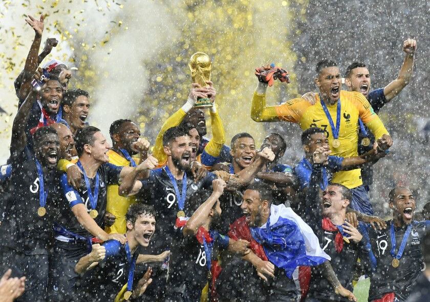 In this Sunday, July 15, 2018 file photo, France goalkeeper Hugo Lloris lifts the trophy after France won 4-2 during the final match between France and Croatia at the 2018 soccer World Cup in the Luzhniki Stadium in Moscow, Russia. World Cup winner France reclaims the No. 1 spot in the FIFA rankings for the first time in 16 years after defeating Croatia 4-2 for its second World Cup title and jumped up six places. (AP Photo/Martin Meissner, File)