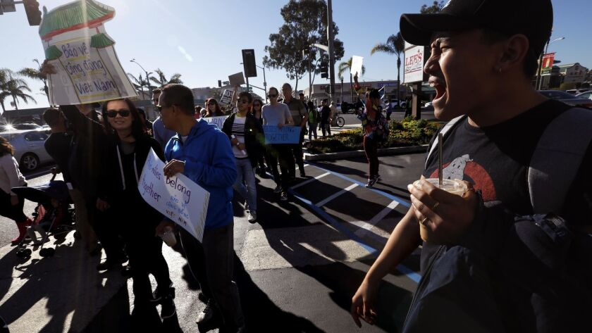 WESTMINSTER, CA - DECEMBER 15, 2018 - - My Nguyen, 24, right, shouts slogans while joining members o