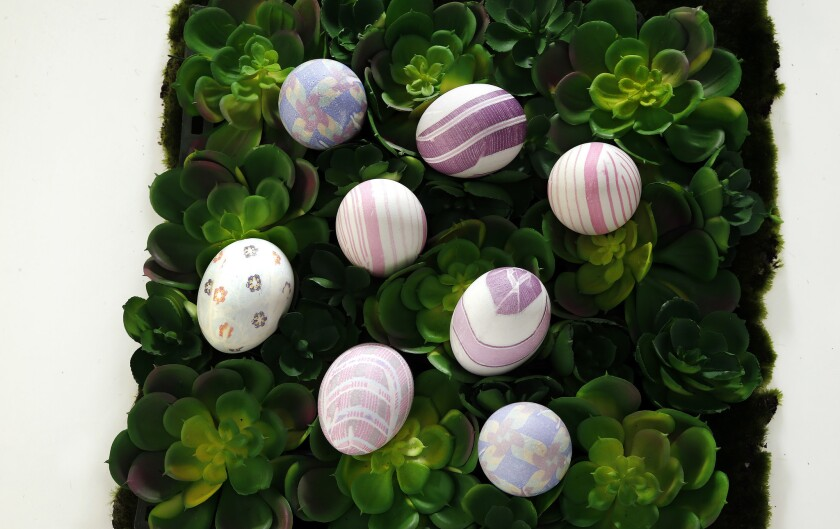 Easter eggs dyed with silk ties technique.