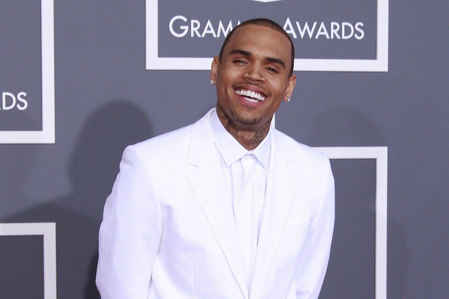 Chris Brown's name evokes controversy these days, so it's easy to forget that he once had a role model image. From high school crooner to R&B star both idolized and vilified, here's a brief look at Chris Brown's life and career. Pictured: Chris Brown at the Grammy Awards in 2013.