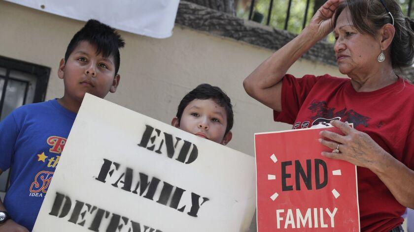 Edgar Ramirez, 11, Aaron Montes, 9, and Bertha Ozuna join demonstrators at Archer Park in McAllen, Texas, to support the #BreakBreadNotFamilies movement to change U.S. immigration policies.