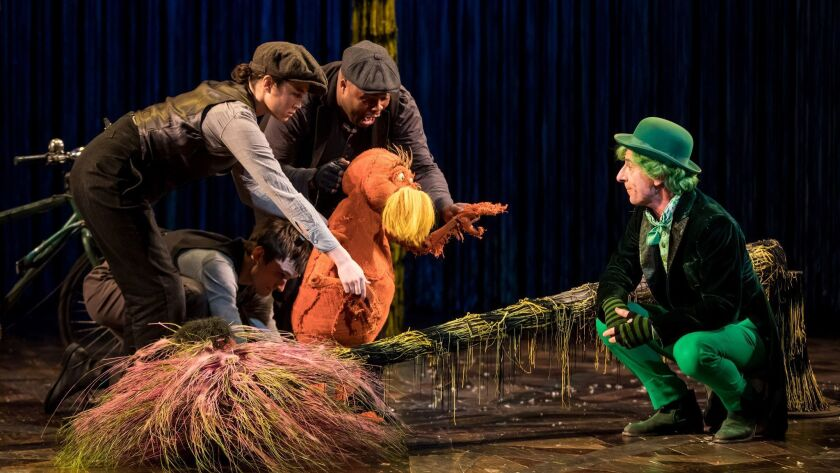 (from left) Meghan Kreidler, Rick Miller, and H. Adam Harris as The Lorax and Steven Epp as The Once