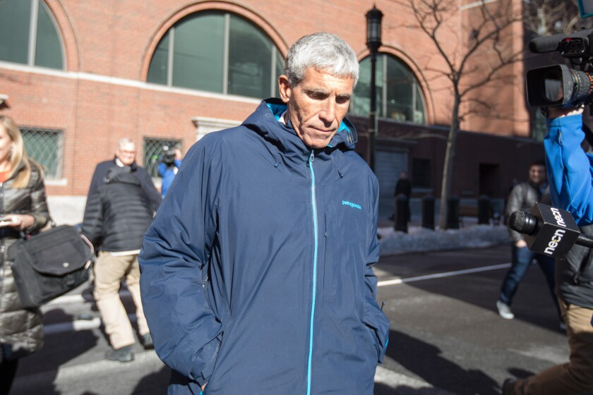 "William ""Rick"" Singer leaves Boston Federal Court after being charged with racketeering conspiracy, money laundering conspiracy, conspiracy to defraud the United States, and obstruction of justice on March 12."